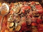 Roasted veggies topped the tomato sauce, and cheese was sprinkled to finish it!