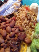 An amazing plate of food with Mexican inspired ingredients and flavors.