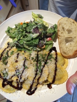 Here it is.  My dinner is all of its naughty gloriousness!   Wild mushroom ravioli with brown butter sauce and balsamic reduction, salad, and, of course, bread. Was it worth it?  Oh heck yes!